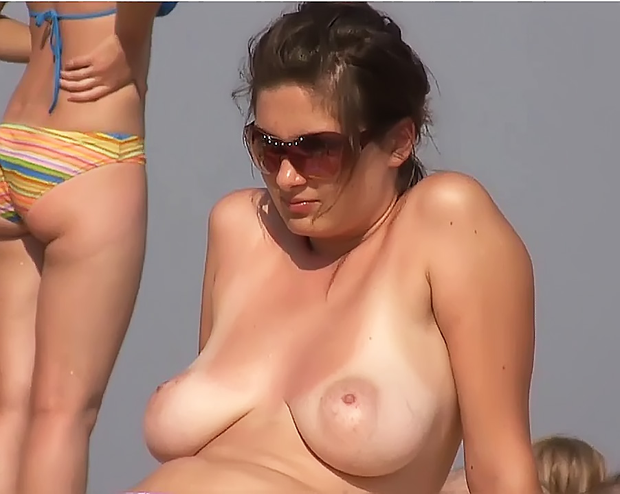 A Fresh Topless  Gets Suntanned On The Beach