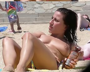 One Topless And One Pantieless Babe On Beach Spy Cam