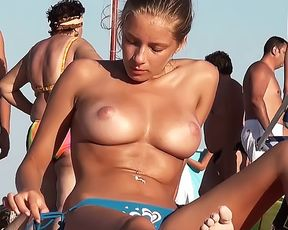 A Fresh Bare-Breasted Chick Gets Suntanned On The Plage