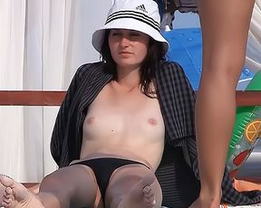 Mature Stripped To The Waist Gal On A Strand