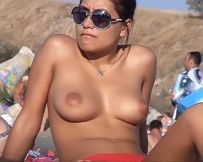 Strap And Bra-Less On The Plage