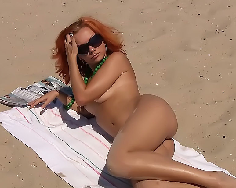 At a nude beach playing with my cock for all to see
