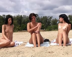 Nudist beach girls posing 2