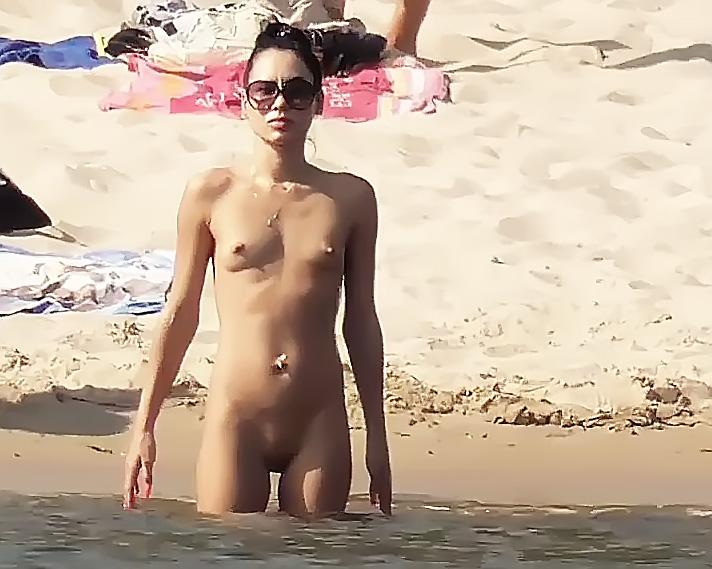 A saw this doll posing to her husband on a nude strand on Kos island.