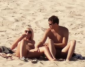 Slim female with perky knockers naked at a naturist plage