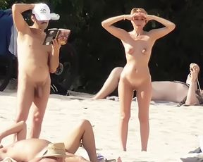 Lovely girls bare their bodies at a naturist strand