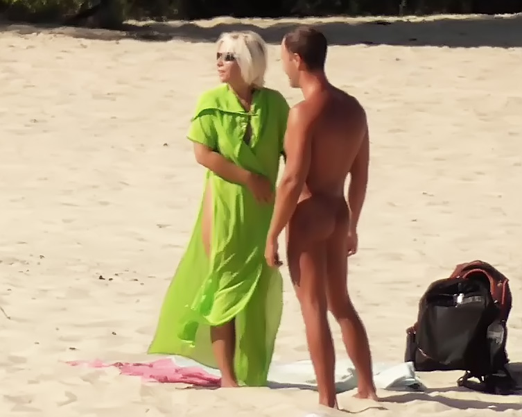 Naturist girls have fun with each other at the strand