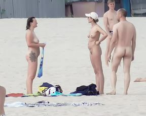 Naughty youthful naturists play with each other in sand