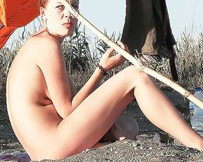 Youthfull naturist friends naked together at the plage