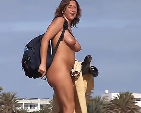 Encountered this smoking-hot babe on nude plage last month.