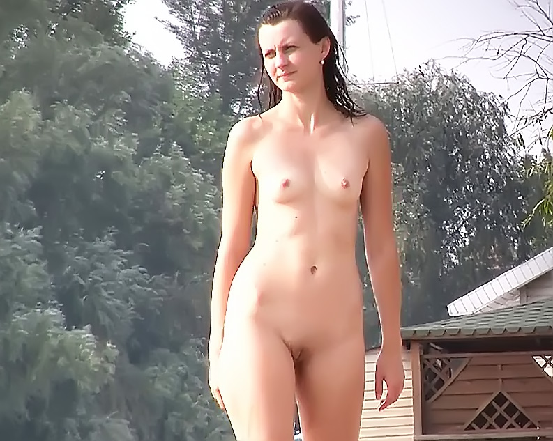 Friendly youthfull Russian naturists lay on the strand 2