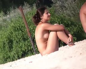 Gorgeous wet youthfull naturist plays in the water 2