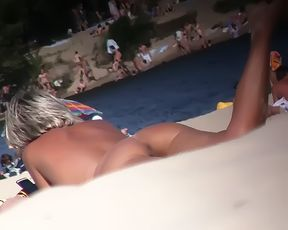 my sexy wife showing her pussy on a naturist plage.....in a lost paradise.... 2