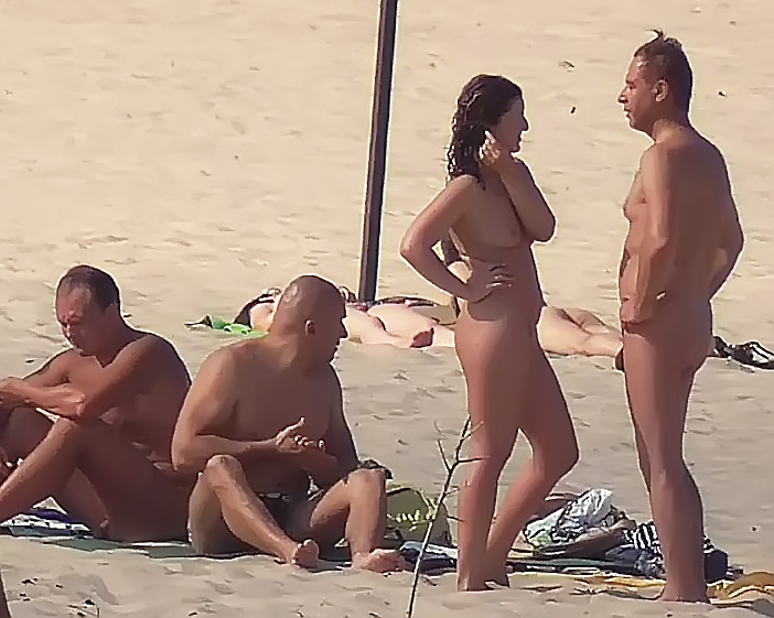 Slim girl with perky boobs naked at a nudist beach 3