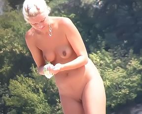 Heating up the beach by exposing her nude figure 2