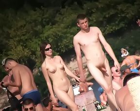 wet has some fun being nude on a public beach 2