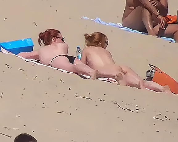 Her sexy body gets a tan after she strips naked 6