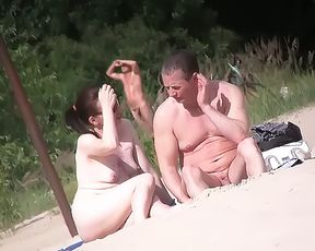 Helping Hand at the Naturist Strand 6