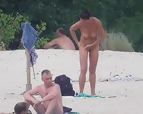 Barely legal youthfull naturist lays naked at the plage 5