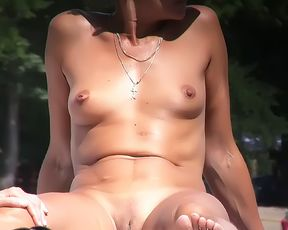 Gorgeous naturist youth gets an all over tan 7