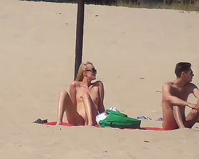 Big boob and slim girl nudists lay out in the sun 3