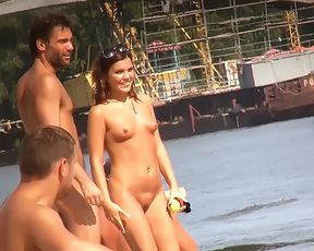 Slim girl with perky boobs naked at a nudist beach 5