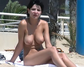 Dashing young nudist brunette with a tight, slim body and perky tits caught on camera