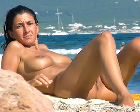 She knows she look sexy. And she likes to stay in the most sexy poses on naturist strand.