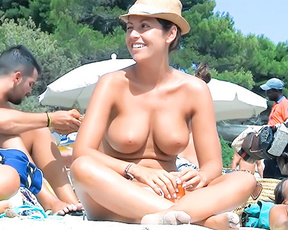 Gorgeous young nudist with  proudly shows her big  tits