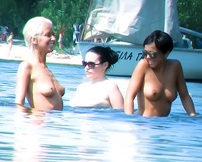 Ravishing young nudists babes secretly filmed by a voyeur relaxing at the beach